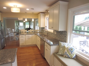 Using the same footprint, this kitchen feels 4 times as large! Removing walls and redesigning the cabinets created the perfect open kitchen for entertaining.