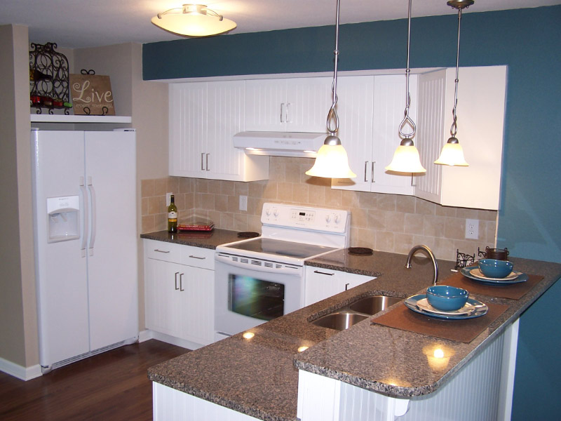 White Kitchen Cabinetry and White Appliances, a GREAT look!
